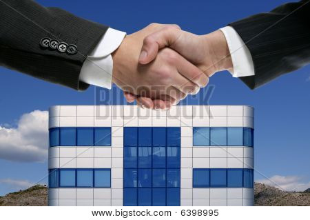 Businessman Handshake Over Mirror Building