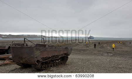 Svalbard, Norway - July 2013: Visiting An Abandoned Rusty Mining Machine in Svalbard