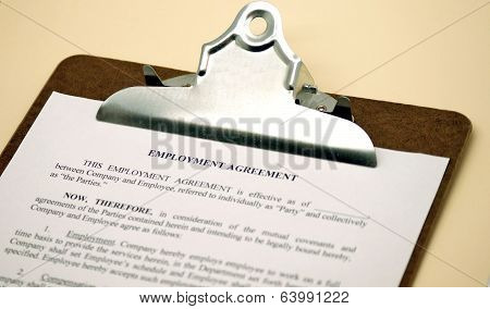 Employment Agreement on Clipboard
