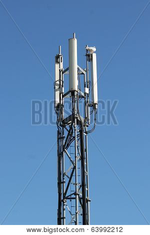 Three-sector mobile telephone base station on lattice girder tower