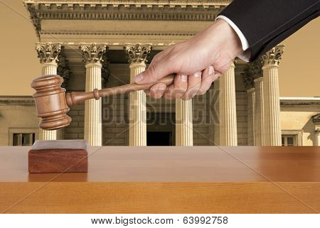 Gavel against the background of the courthouse