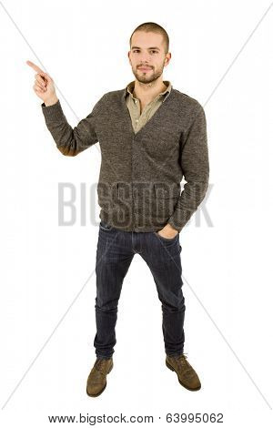 young casual man full body pointing, isolated on white