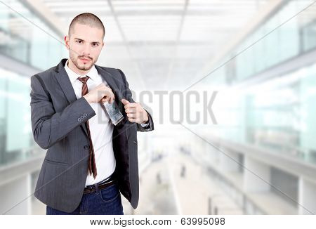 young businessman with money at the office