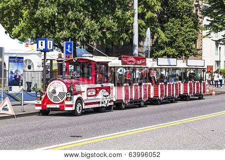 Touristic train in Lugano waiting for tourists to carry them around