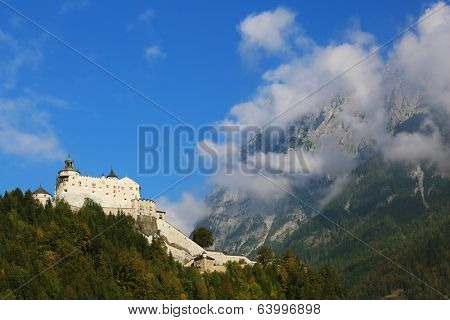 Majestic medieval Burg Hohenwerfen. Fortress it is located at top of the mountain and it is surrounded with the dense wood