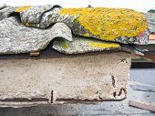 stock photo of derelict  - Particular gutter cover slabs of cement and asbestos - JPG