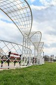 foto of pergola  - White metal park pergola with bench and green grass - JPG