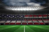 picture of football pitch  - Digitally generated american national flag against large football stadium - JPG