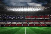 foto of football pitch  - Digitally generated american national flag against large football stadium - JPG