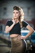 stock photo of tights  - Attractive young woman in a urban fashion shot - JPG