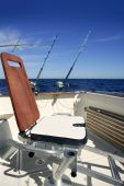 stock photo of yellowfin tuna  - Big game boat wooden fishing chair for tuna wahoo and marlin - JPG