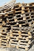 picture of wooden pallet  - stack of empty wooden pallets in warehouse yard outdoors - JPG