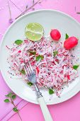 foto of grated radish  - Fresh radish grated for a delicious salad - JPG