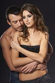 picture of hunk  - A sexy young topless couple embracing with closed eyes - JPG