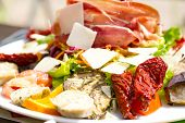 picture of antipasto  - antipasto with ham parmesan cheese fish and dried tomatoes - JPG