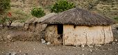 stock photo of excrement  - traditional maasai hut made of cow excrement  - JPG