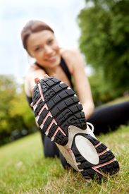 image of workout-women  - Beautiful woman doing gym stretches on the grass outdoors - JPG