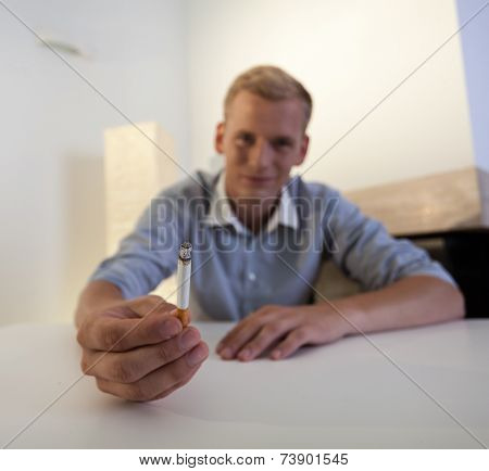Addicted Man Holding A Cigarette