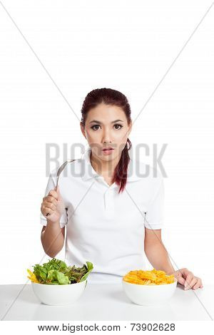 Asian Girl Surprise With Salad And Crisps