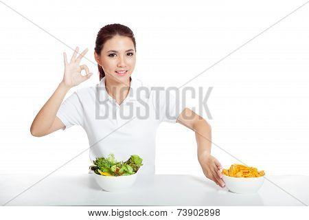 Asian Girl Show Ok Sign For Salad Push Crisps Away