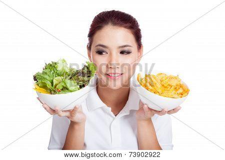 Asian Girl Choose Salad Over Crisps