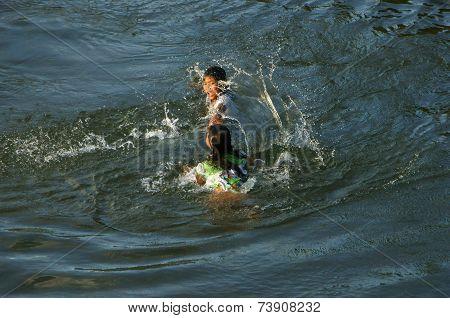 Asian Children Bath On Vietnamese River