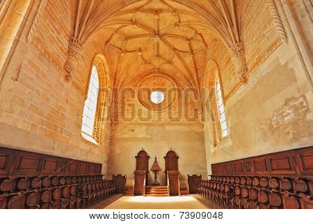 TOMAR, PORTUGAL - SEPTEMBER 29, 2011: The imposing medieval castle of the Knights Templar in Portugal. The magnificent chapel with a vaulted ceiling and rows of oak chairs