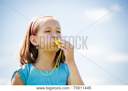 Child blowing whistle