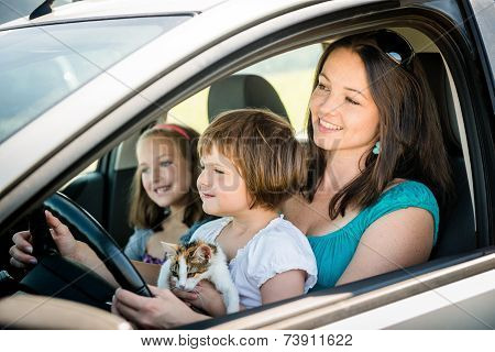 Mother and child driving car