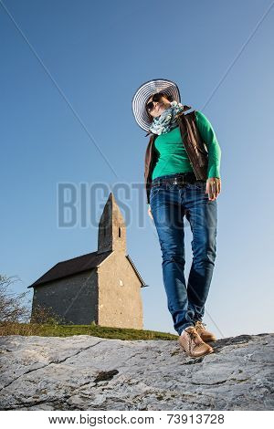 Posing Young Woman In A Stylish Hat And An Old Romanesque Church Archangel Michael
