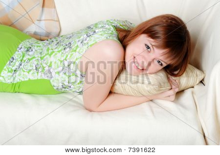 Young Lovely Brunette In Green Pajamas