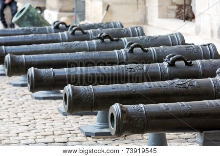 Historic cannon in Les Invalides museum in Paris France.