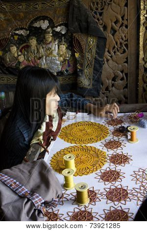 Burmese Woman At Work Sewing Beads