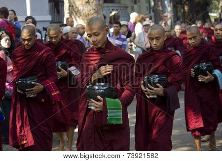 Monks in a row for lunch