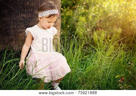 Beautiful Toddler In Forest