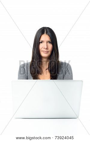 Skeptical Young Woman Using Laptop