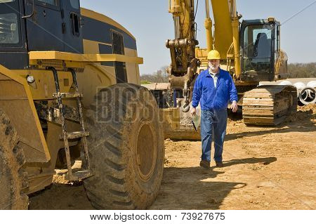 Construction Worker And Heavy Equipment