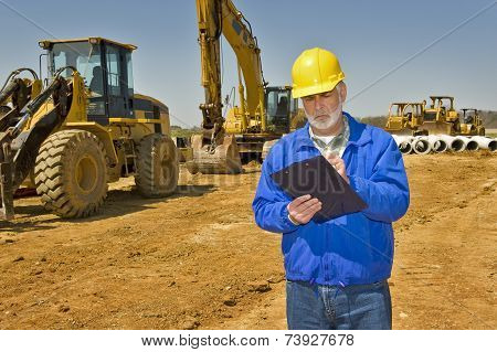 Supervisor Taking Notes On Site