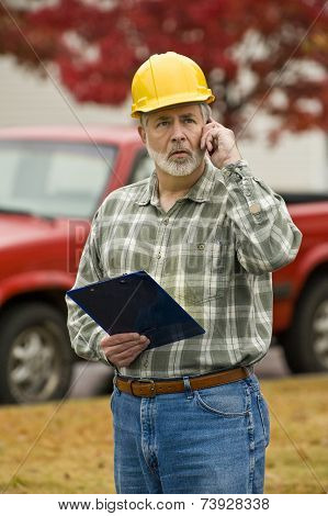 Construction Supervisor On Phone