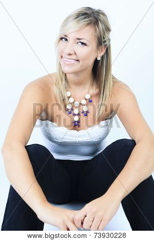 Attractive blond woman on studio