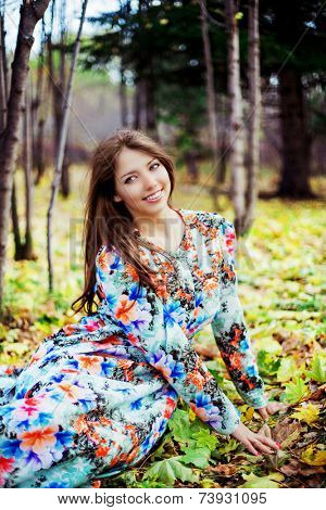beautiful brunette woman in the autumn park