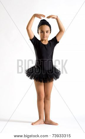 Small Ballerina Striking A Graceful Pose