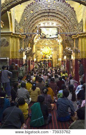 People Praying At The Buddha