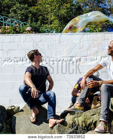 Two men intrigued by a bubble, Portmeirion