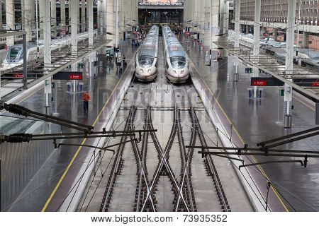 MADRID, SPAIN - OCTOBER 9, 2014: High speed trains in Atocha Station in Madrid. Spain's main cities are connected by high-speed trains.