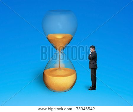 Standing Man Watching Hourglass