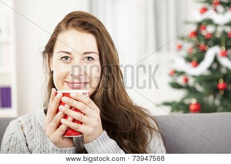 Young Girl Enjoy Hot Coffee At Christmas