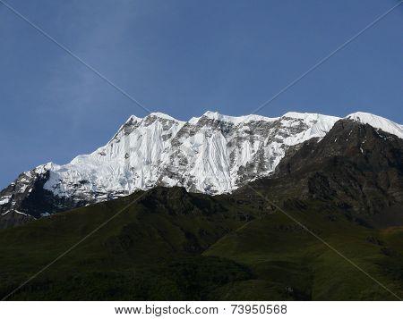 Green Hills Before Snowy Annapurna Iv Himalayan Peak
