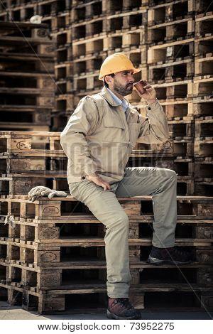 Warehouse worker having a break with coffee
