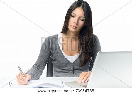Serious Young Woman Working At A Desk